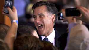 Republican presidential candidate, former Massachusetts Gov. Mitt Romney reacts while greeting supporters at a rally in Schaumburg, Ill., after the winning the Illinois Republican presidential primary, Tuesday, March 20, 2012.