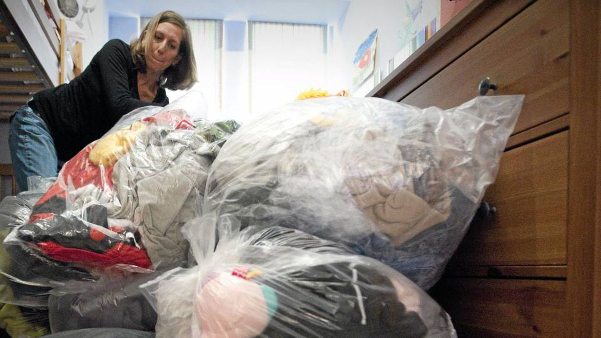 Marsha Lederman sorts through bags of clean clothing July 21, 2010 at her home in Vancouver after having a bedbug infestation.