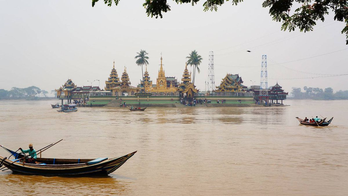 Families hop aboard small ferries to get to the Ye Le Paya, or Mid-stream Pagoda, a short drive outside Yangon.