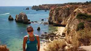 Natalie Stechyson hikes the cliffs that weave behind the beaches in Lagos, Portugal.
