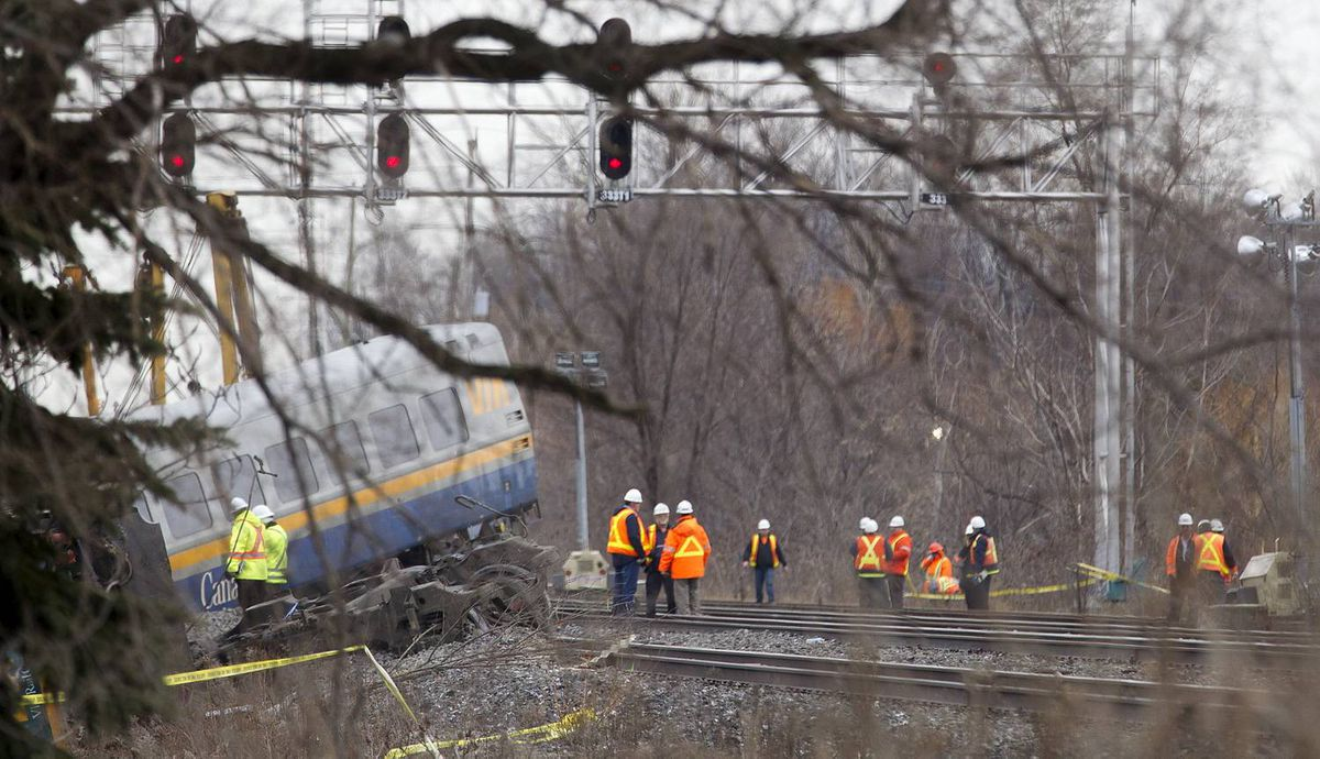 BURLINGTON, ONT. - Feb. 27, 2012 - The Via passenger train, enroute from Niagara Falls to Toronto, derailed on Sunday at approximately 3:30pm. Three VIA employees in the engine died as a result if the crash, and many passengers were taken to local hospitals; three with serious injuries. (Photo by Peter Power/The Globe and Mail)pmp