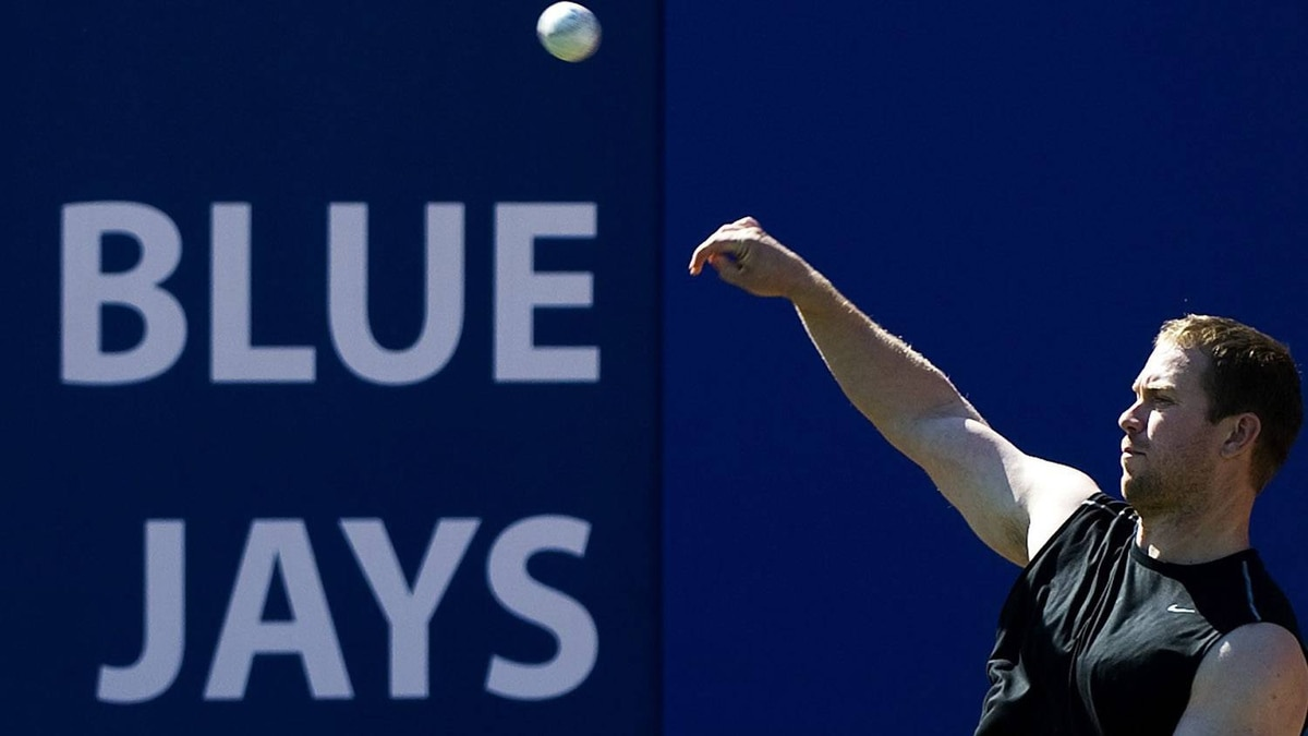 Toronto Blue Jays infielder Aaron Hill throws the ball during spring training in Dunedin, FL, on Sunday, Feb. 13, 2011. THE CANADIAN PRESS/Nathan Denette