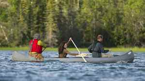 The Duke and Duchess of Cambridge take a canoe ride with elder Francois Paulette from the Fort Smith area at Lake Blatchford Lake, NWT., lodge on July 5, 2011.
