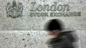 A woman walks passed the London Stock Exchange at Paternoster Square in London in this, April 12, 2006 file photo.