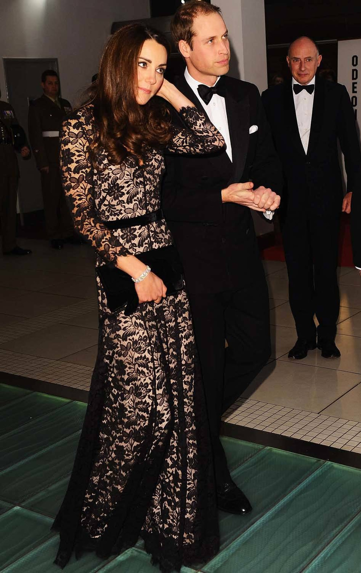 Kate attends the London premiere of the film War Horse in a slinky black lace Temperley gown on January 8.