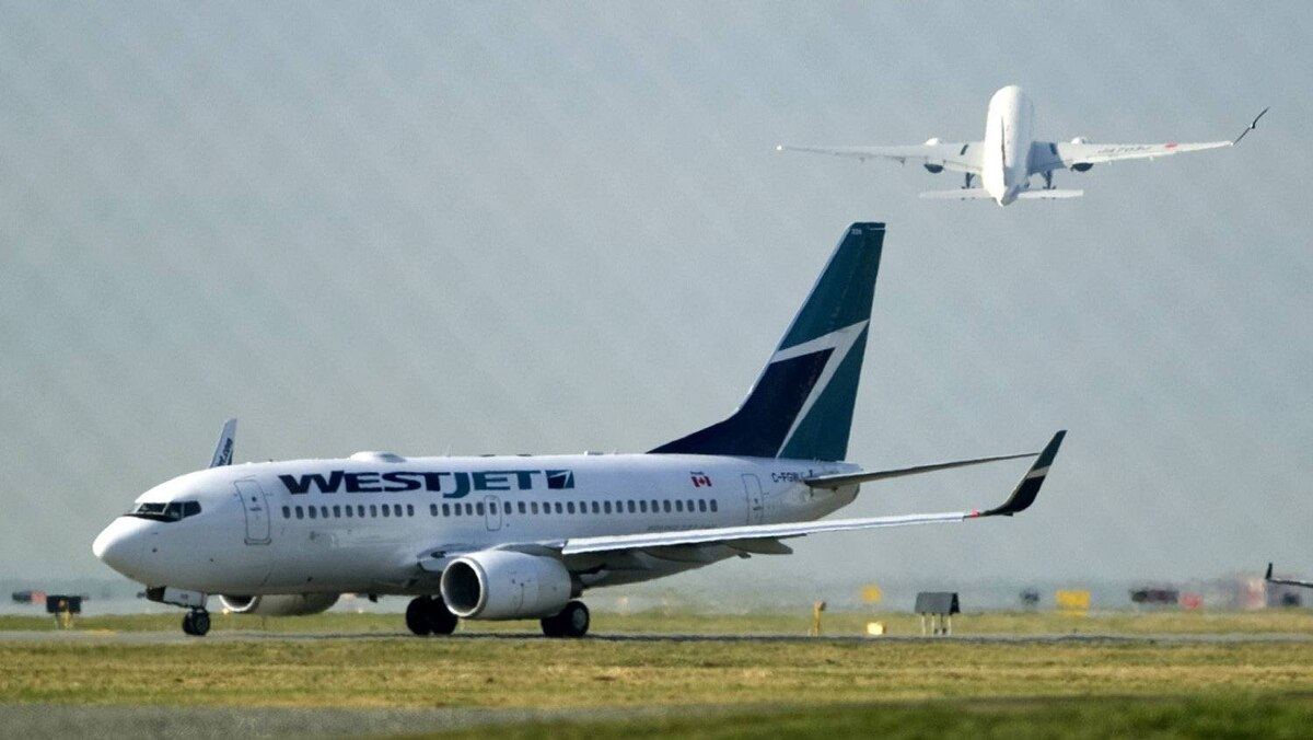 A West Jet plane departs Vancouver International Airport