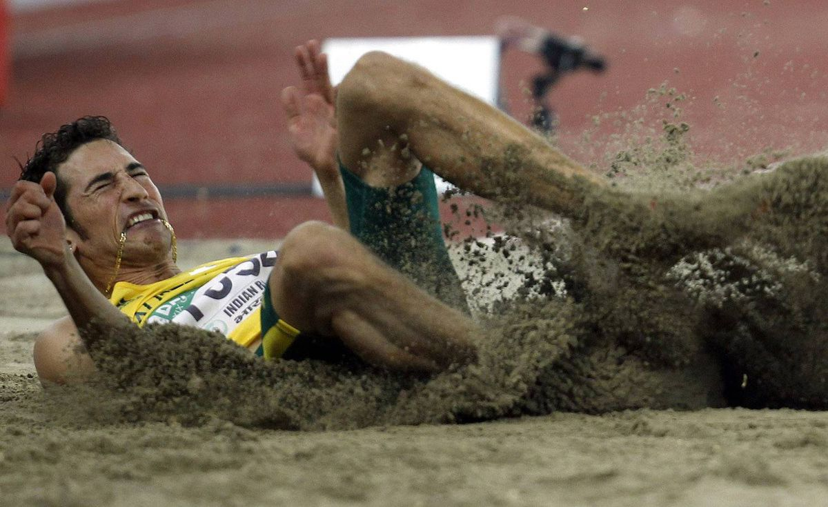 Australia's Fabrice Lapierre competes in the men's long jump event during the Commonwealth Games in New Delhi October 9, 2010. REUTERS/Danish Ismail