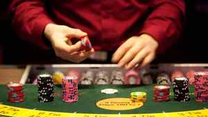 A croupier places gaming chips on a card table at Aspers Casino at Westfield Stratford City Mall in London, U.K. on Wednesday, Jan. 11, 2012.