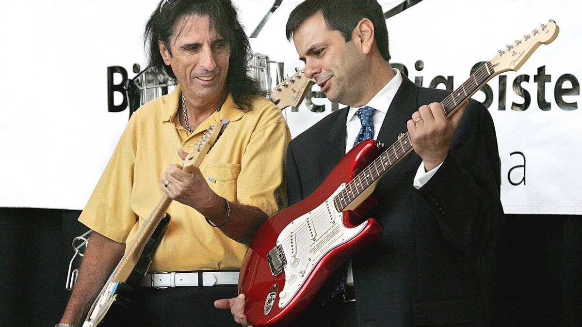 Rocker Alice Cooper, left, and then Phoenix Mayor Phil Gordon hold Fender Stratocasters at the launching of Guitar Mania in 2005, a civic arts project involving the display of 10-foot tall replicas of Fender Stratocasters designed and decorated by local and celebrity artists.