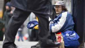Dave, a homeless panhandler, asks for handouts on the corner of Burrard and West Georgia Streets in Vancouver on Jan. 4, 2011.
