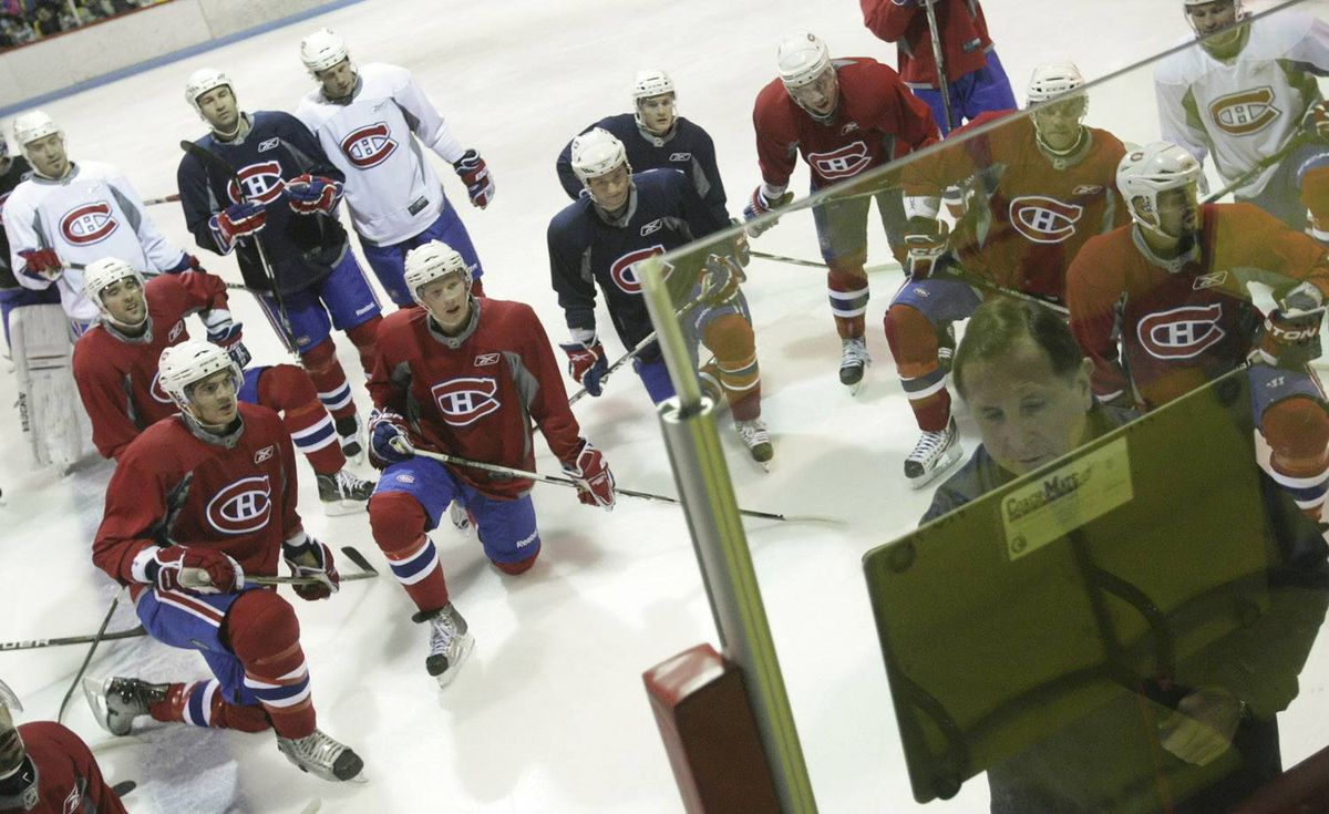 Montreal Canadiens coach Jacques Martin writes on a board as players look on during a practice in Clermont, 150km East of Quebec City, Wednesday October 6, 2010. Francis Vachon