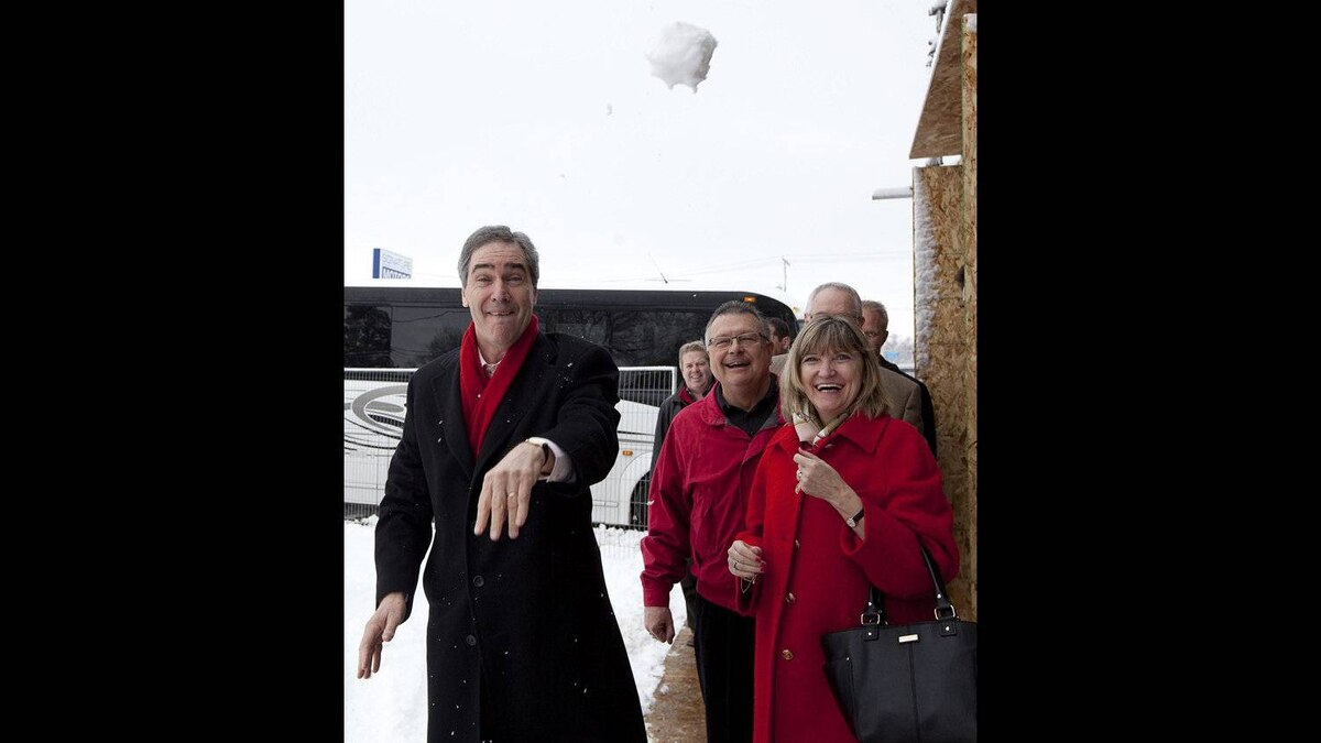 Liberal leader Michael Ignatieff throws a snowball towards photographers as his wife Zsuzsanna Zsohar and liberal candidate Ralph Goodale, second right, look on during a campaign stop in Regina, Sask, Saturday, April 16, 2011.