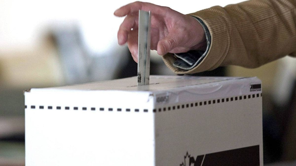 A Toronto man casts his ballot in the federal election on May 2, 2011.