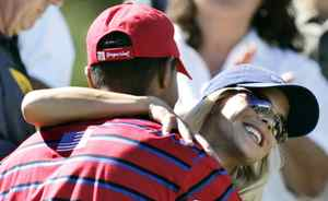 U.S. Ryder Cup player Tiger Woods celebrates with fiancee Elin Nordegren at the 35th Ryder Cup at Oakland Hills Country Club in Bloomfield Township, Mich., on Sept. 18, 2004.