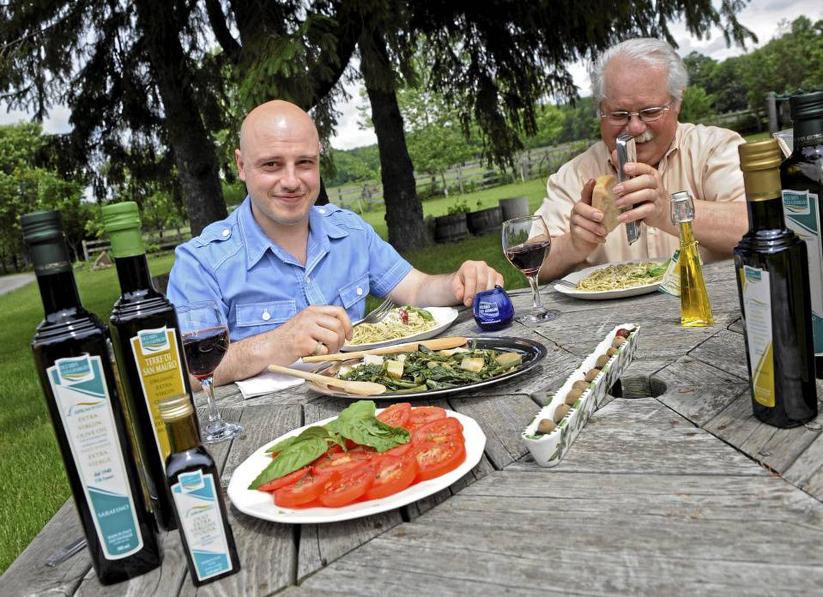 Vincenzo Tramonti, right, used to bring back a few bottles of olive oil after visiting his cousins in Calabria. 'They kept asking for more,' he says, so he formed Sarafino with son Angelo to import the olive oil and other specialty Italian foods. KEVIN VAN PAASSEN/THE GLOBE AND MAIL