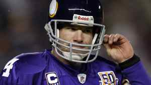 Minnesota Vikings quarterback Brett Favre heads to the sidelines after he throws a pass intercepted by Chicago Bears' Julius Peppers during the first quarter of their NFC, NFL football game at TCF Bank Stadium in Minneapolis, December 20, 2010.