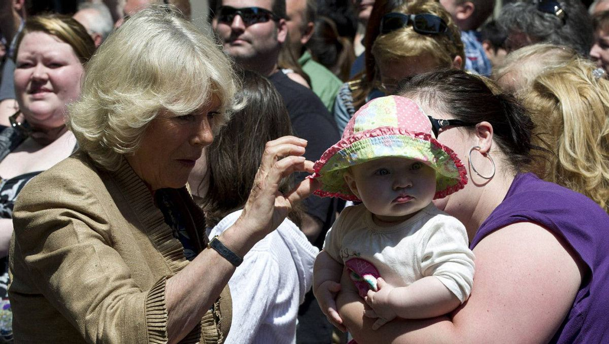 A young child shies away from the Duchess of Cornwall during a walk about Saint John, N.B., on Monday, May 21, 2012. The royal couple are on a three-day visit to Canada to mark the Queen's Diamond Jubilee.