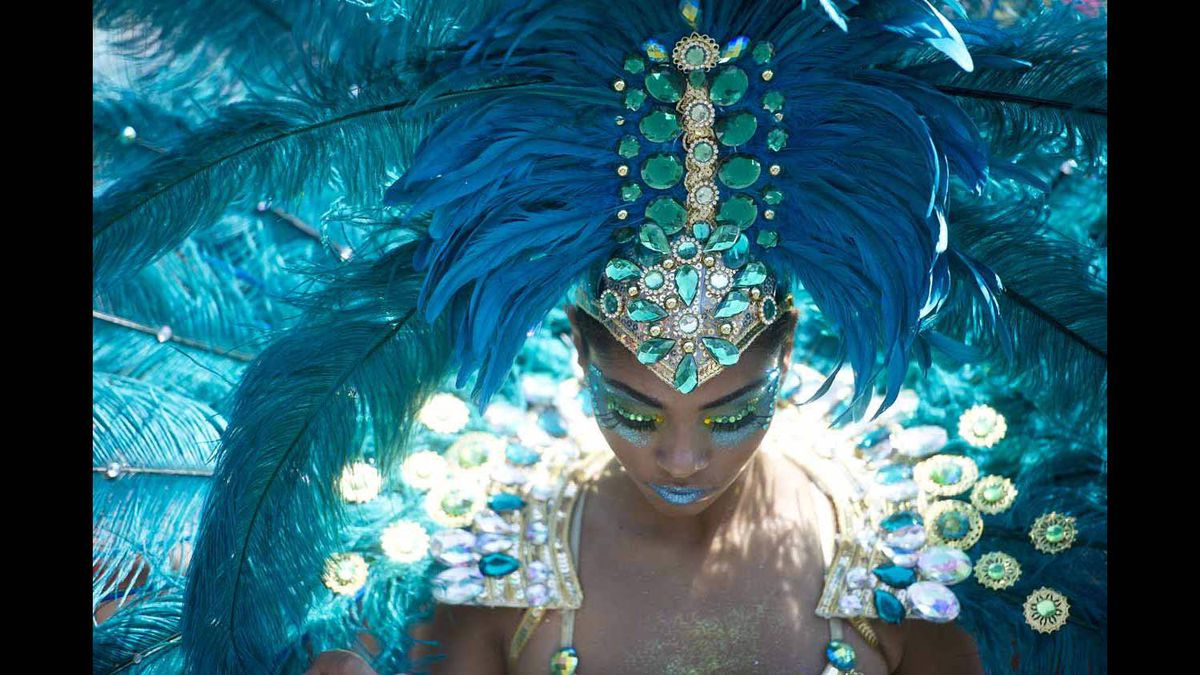 A member of the Caribbean Carnival parade takes a break.