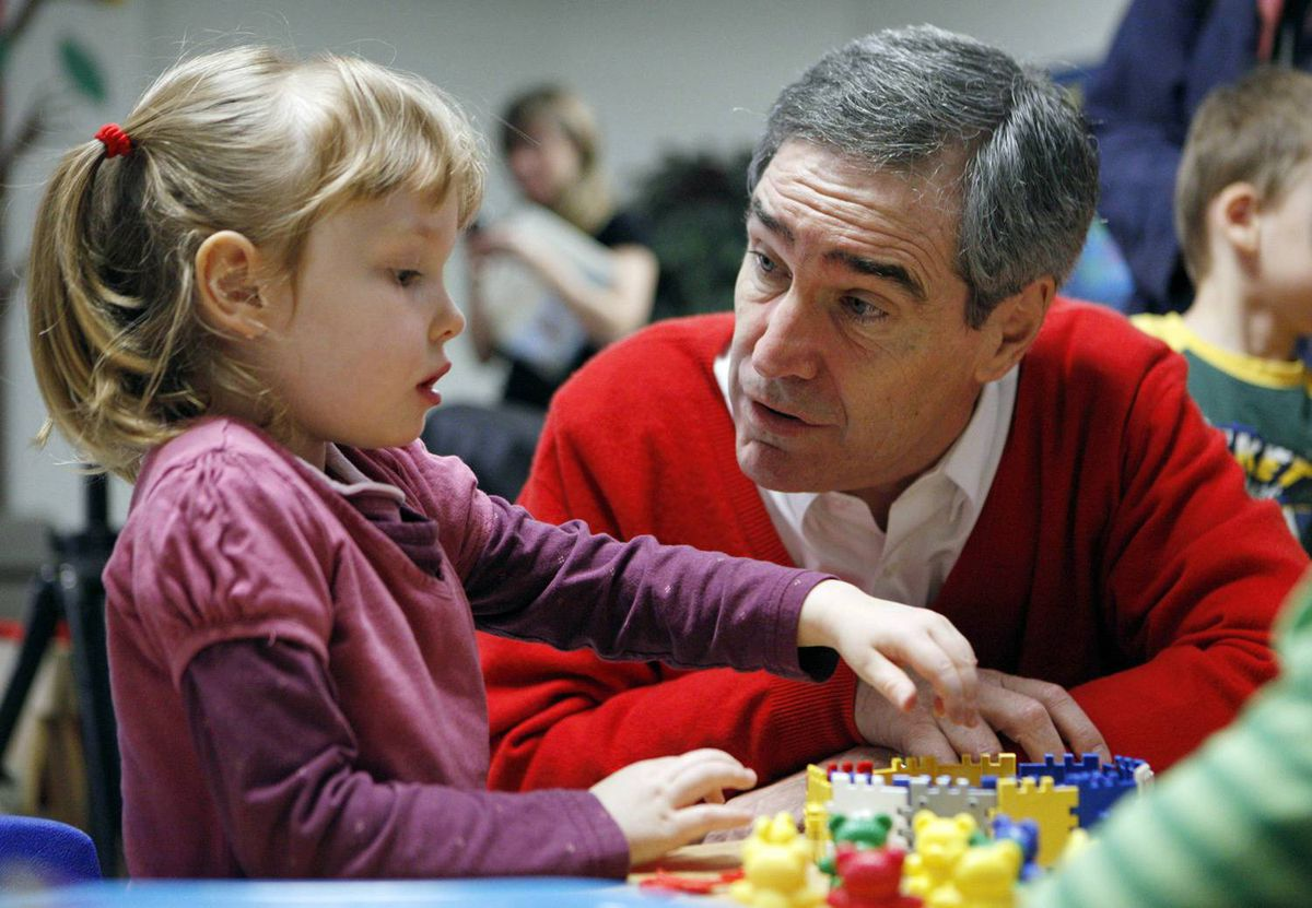 Liberal Leader Michael Ignatieff interacts with student Payton Kelly before reading a book to a pre-kindergarten class, at an early childhood learning centre in Ottawa on October 20, 2009.