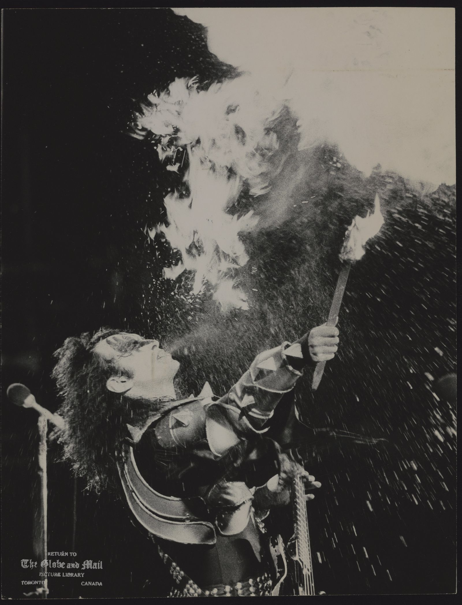 KISS (musical group) Kiss guitarist spews flames from his mouth during show at Varsity Stadium.