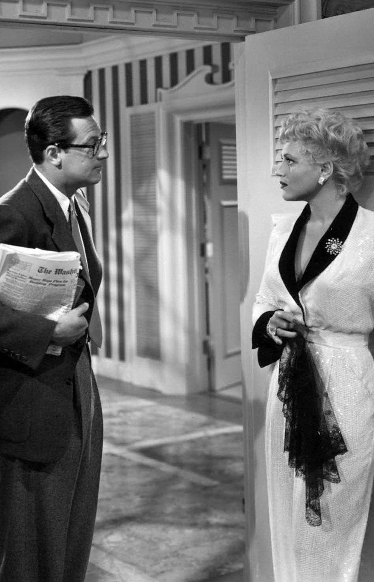 MOVIE Born Yesterday TCM, midnight ET; 9 p.m. PT Required viewing for any serious cineaste, this 1950 comedy marked the career peak of the late, great Judy Holliday. The blonde comic actress earned an Oscar for her portrayal of Billie, the shrill ex-chorus girl mistress of crooked junk tycoon Harry Buck (Broderick Crawford). While in Washington to bribe some politicians, Harry tries to improve Billie's crass manners by hiring the impoverished journalist Paul (William Holden) to school her in the social graces. The results are positively Pygmalionesque.