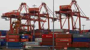 Cargo containers are stacked up as three cranes used to load and unload them from cargo ships tower above at the Port of Vancouver in Vancouver, B.C., on Thursday October 16, 2008.