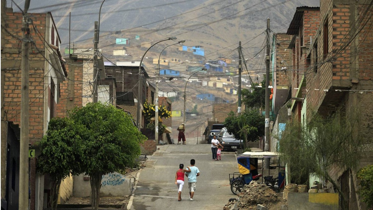 Children play on the street in the Comas district of Lima Feb. 10, 2012.
