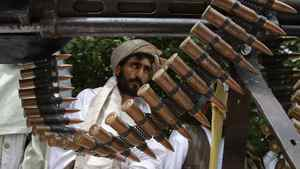 Taliban militants hand over their weapons after joining the Afghan government's reconciliation and reintegration program, in Herat province May 14, 2012.