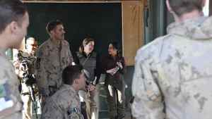 Journalist Michelle Lang, centre left at rear, chats with Bushra Saeed during their mission briefing in Kandahar, Afghanistan, Dec. 30, 2009. Also taking part in the briefing is Sgt. Kirk Taylor, left rear, Cpl. Barrett Fraser, standing centre, Cpl. Taylor Lewis, sitting centre, Cpl. Fedor Velochtchik, left, and Cpl. Stu Shier, right. Hours later an improvised explosive device destroyed one of the vehicles they were travelling in on their way back to base.