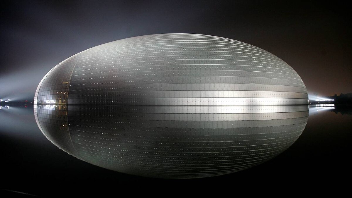 The National Grand Theatre stands surrounded by water in central Beijing