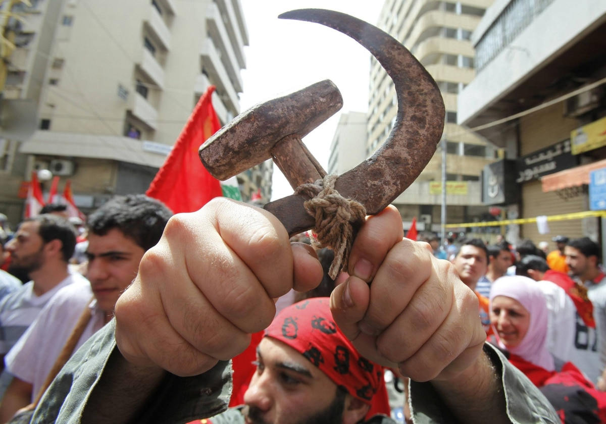 A Lebanese leftist activist holds up a hammer and sickle, a symbol of communism, during a demonstration to mark Labour Day, or May Day, in Beirut.