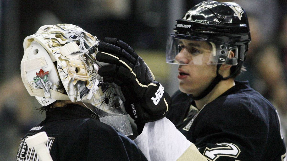 Pittsburgh Penguins center Evgeni Malikn (71) playfully congratulates Pens goalie Marc-Andre Fleury (29) on his 200th career win after defeating the Buffalo Sabres at the CONSOL Energy Center. The Pens won 8-3. Charles LeClaire-USPRESSWIRE