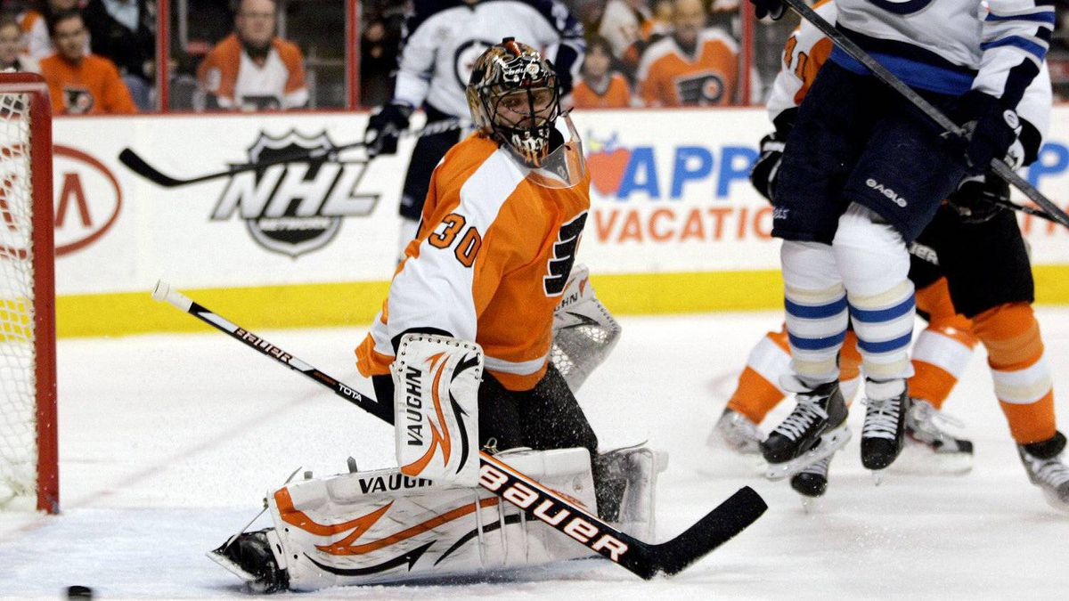 Philadelphia Flyers goalie Ilya Bryzgalov (30), of Russia, follows the puck as Winnipeg Jets' Andrew Ladd (16) jumps out of the way during the first period of an NHL hockey game, Tuesday, Jan. 31, 2012, in Philadelphia.