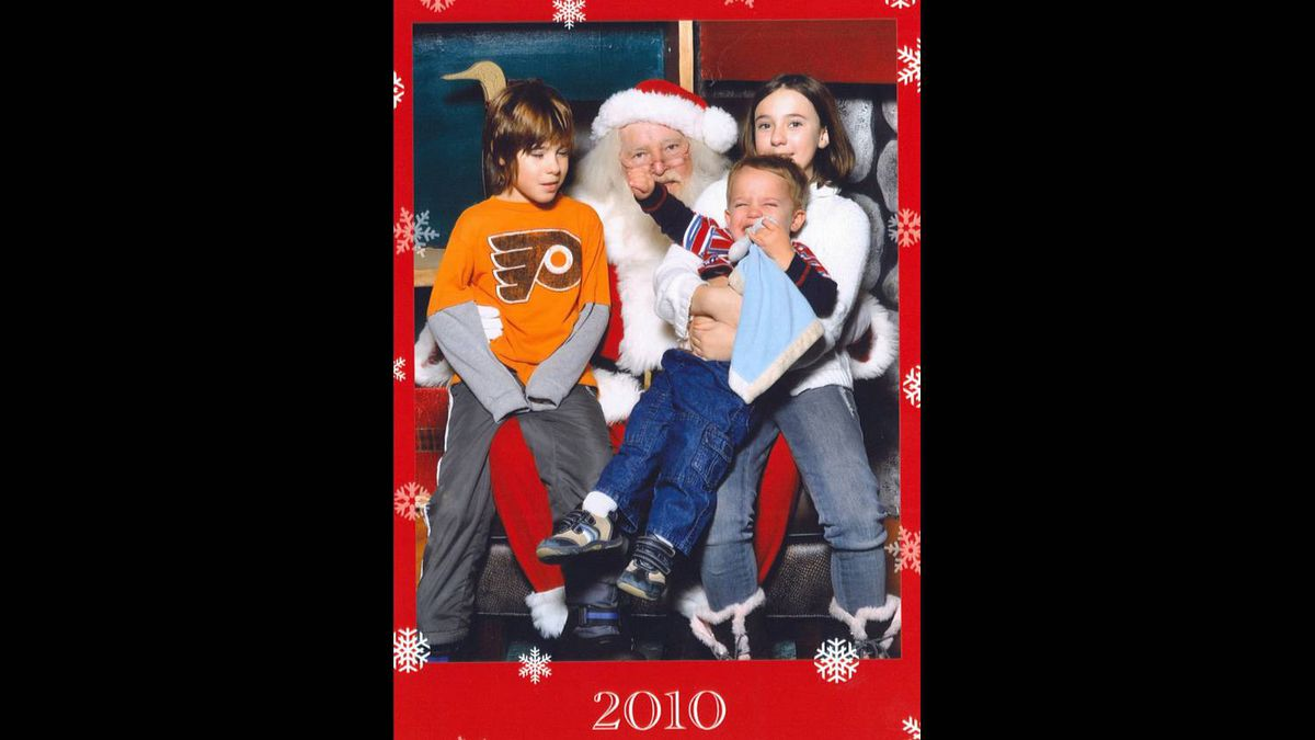 Lyndsay Kerik photo: A little punch in the face for Santa - Apparently Austin did not like Santa this year even with his cousin Emily (who has a tight hold) and his cousin Nicholas who isn't sure what is happening.