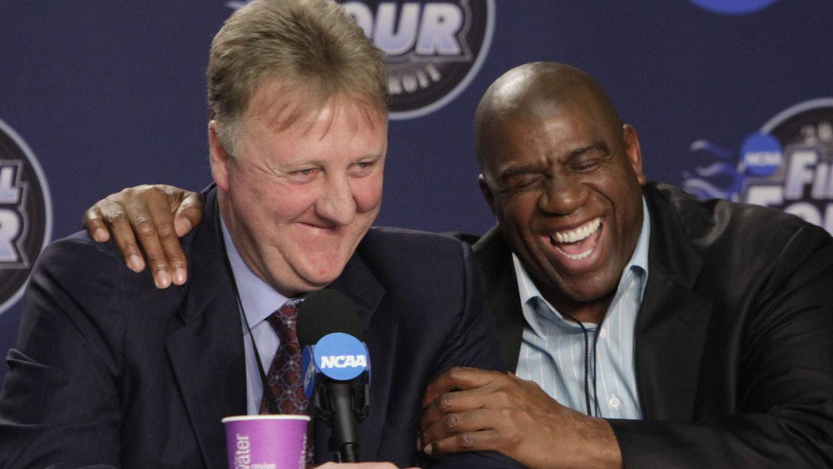"""In this April 6, 2009 file photo, former NBA players Earvin """"Magic"""" Johnson, right, and Larry Bird laugh at a news conference before the championship game between Michigan State and North Carolina at the men's NCAA Final Four college basketball tournament in Detroit. Johnson continues his zest for life 20 years after being diagnosed with HIV. (AP Photo/Paul Sancya)"""