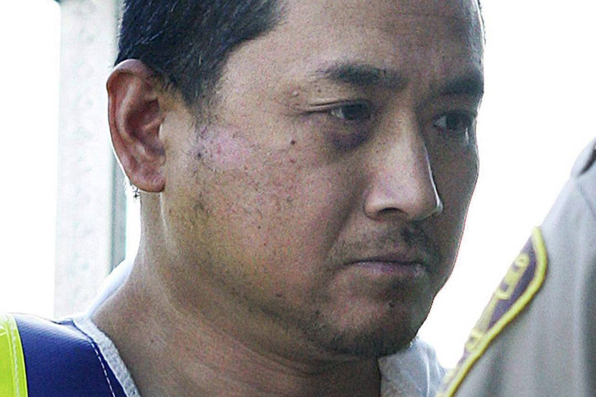 File photo of to Vince Li, who was found not criminally responsible for stabbing and decapitating Tim McLean in July, 2008, near Portage la Prairie. Vince Li is shown in a Portage La Prairie, Man., court Tuesday, August 5, 2008.