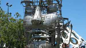 """Christian Ristow brought his 12-foot mechanical art exhibit """"Face Forward"""" to this year's Maker Faire. """"We have an interesting musculature in our faces that serves no other purpose than communication,"""" he said. Ristow's piece took three months to build, and has 12 different facial features that can be controlled individually by users with joysticks."""