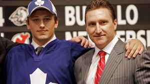 Jiri Tlusty, left, poses for a photo with former Toronto Maple Leafs general manager John Ferguson at the 2006 NHL Entry Draft in Vancouver.