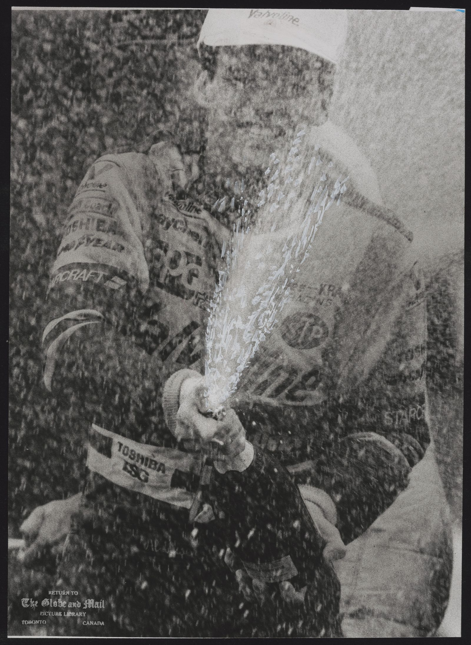 AUTOMOBILE RACING MOLSON INDY AL UNSER CELEBRATES HIS VICTORY YESTERDAY IN TORONTO AT THE MOLSON INDY CAR RACE. HE IS THE FIRST-TWO-TIME WINNER OF THE 5-YEAR OLD EVENT.