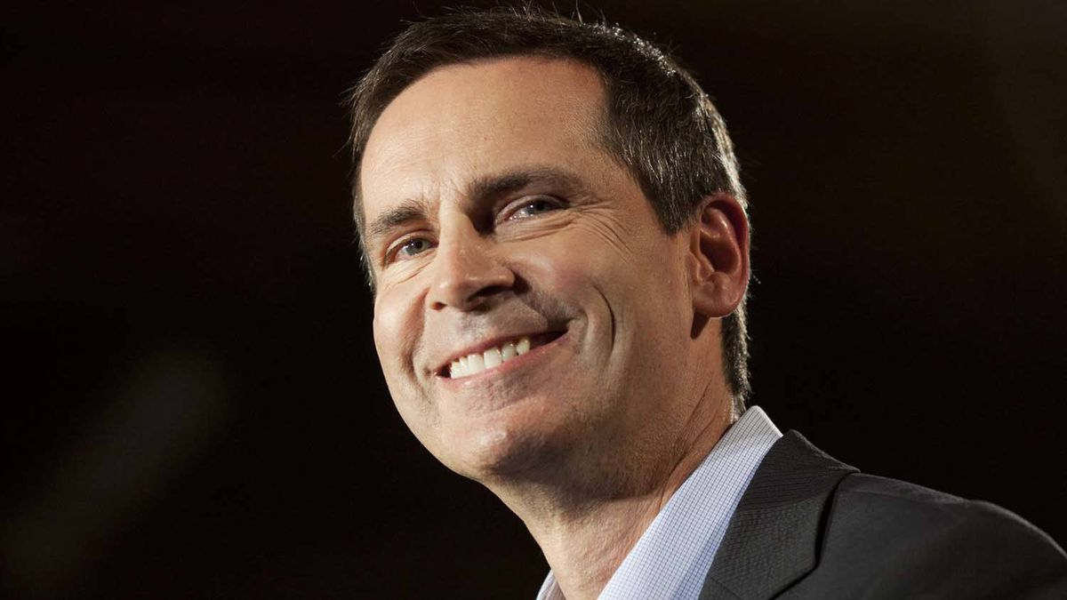 Ontario Premier Dalton McGuinty smiles as he releases the Liberal Party election platform during a news conference in Toronto Sept. 5, 2011.