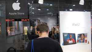 A customer looks at products at an alleged fake Apple store in Kunming, in southwest China's Yunan province.
