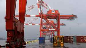 Idle container cranes are seen on a pier at the Port Newark Container Terminal near New York City in Newark, N.J.