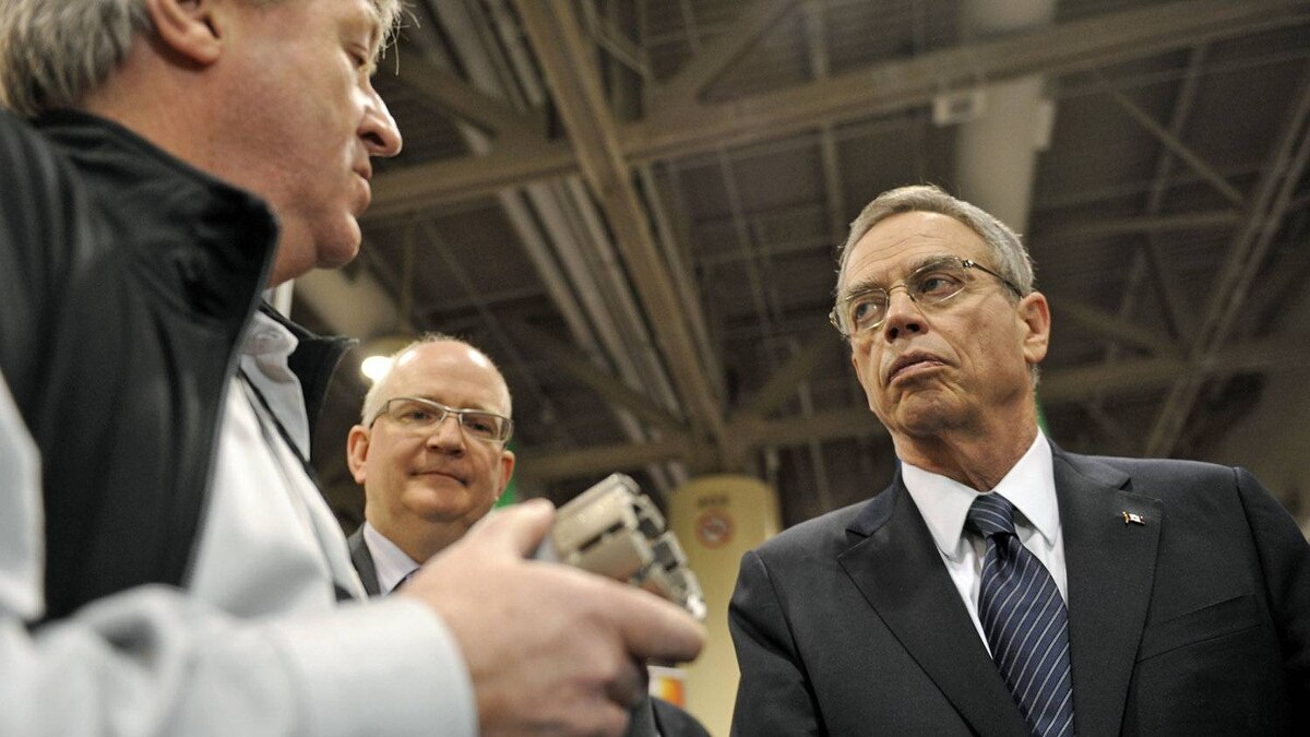 Natural Resources Minister Joe Oliver chats with a vendor at mining conference in Toronto on March 5, 2012.