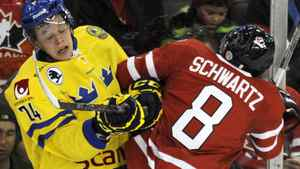 Team Sweden's Rickard Rakell (L) and Team Canada's Jaden Schwartz collide during the first period of their exhibition hockey game in Edmonton December 23, 2011. REUTERS/Dan Riedlhuber