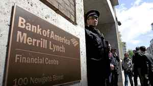 A police officer guards the entrance to a Bank of America Merrill Lynch office in London, U.K., on Tuesday, May 15, 2012. Royal Bank of Canada is said to be interested in acquiring B of A's wealth management business outside the U.S.