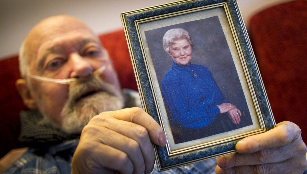 Walt Sturhahn holds a picture of his late mother, Katie Sturhahn, at his home in Vancouver.