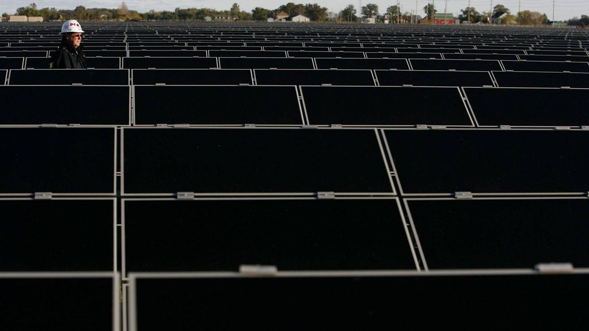 Steve Nagy of First Solar walks through rows of solar panels at the Sarnia Solar Project, the largest operating photovoltaic facility in the world, in Sarnia, Ont.