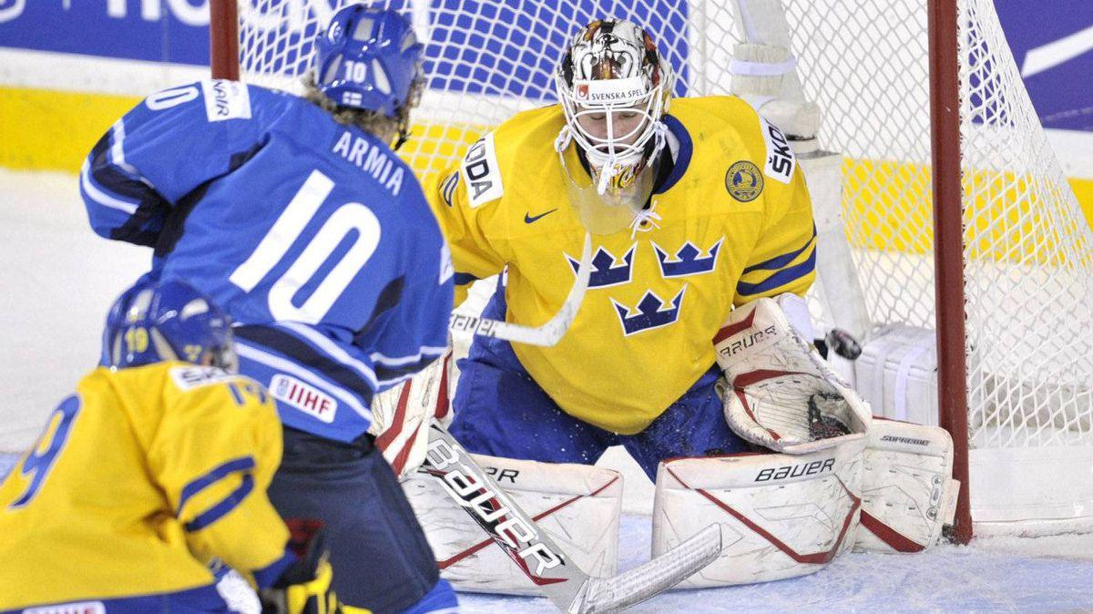 Finland's Joelæ Armia scores on Team Sweden goaltender Johanæ Gustafsson in the semi-final game in Calgary.