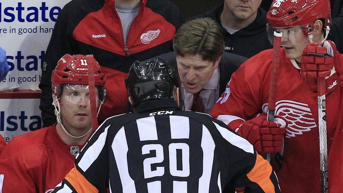 Detroit Red Wings head coach Mike Babcock talks to referee Tim Peel (20) during the second period of Game 3 of an NHL hockey Stanley Cup first-round playoff series against the Nashville Predators in Detroit, Sunday, April 15, 2012. (AP Photo/Carlos Osorio)