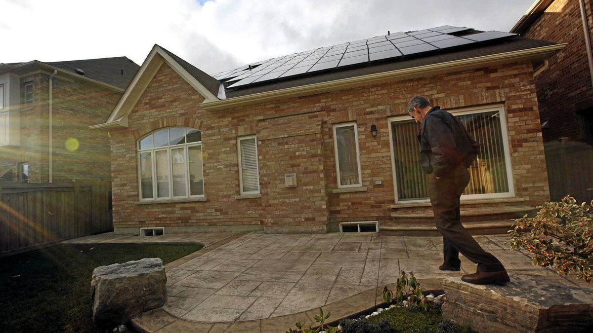 Paul Ford, who agreed to have solar panel put on the roof of his house, poses for a photo at his home in Mississsauga, Ontario, Canada.